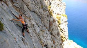 Karine warming up on the slab at Summertime Crag.