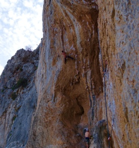 Pulling the crux on Kerveros 7a Spartacus Wall